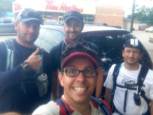 A selfie in a Tim Hortons parking lot with 4 guys about to start a running event.