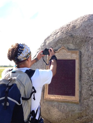 Dallas taking a photo of bees that were hanging out on the plaque.